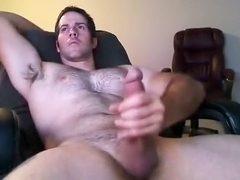 Fascinating gay is masturbating in the guest room and filming himself on computer webcam