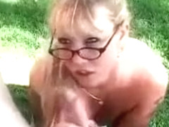 Big boobed blonde MILF whore sucking