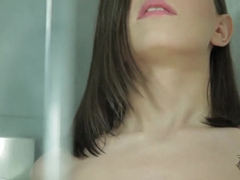 Neona fingers herself in a steamy shower