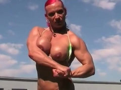 Mature muscle woman rubs her big clit