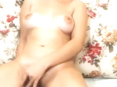 Webcam girl strips and masturbates