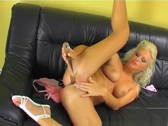 Sexy blonde Kathy Anderson uses a glass dildo to drill her fiery holes