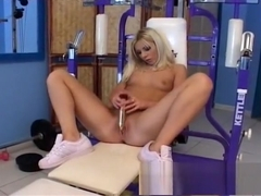 Sexy blonde with a hot ass gets naked and has a workout with her dildo