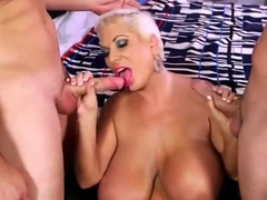 Bimbo mature loves to fuck two junior cocks