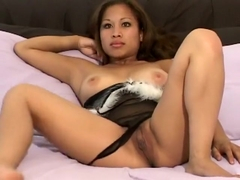 Big breasted Asian girl Nalani shows off her spicy ass and pink pussy