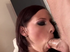 Gianna Michaels giving a head to enslaved guy
