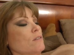 A hot MILF is ate out by a cute young stud