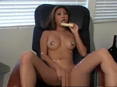 Bodacious Nicole Oring teases with a banana and rubs her tight peach