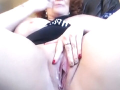 A Redhead Is Teasing Her Sex Toy