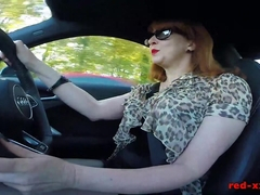 Big tit British mature Red masturbating in the car