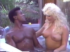 Sexy blonde has fun with her black lover