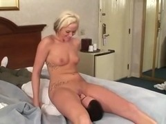 Playing with her vibrator while him