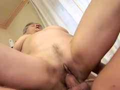 Buxom granny works her hot lips and her aching pussy on a long shaft