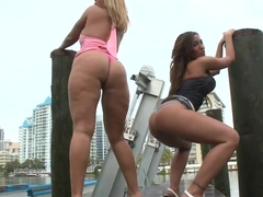 Melanie and Adriana bend over for the camera