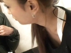 Asian beauty shows her cleavage in this downblouse voyeur video