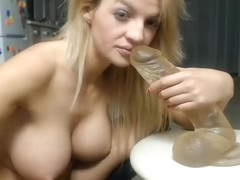 A Blonde Is Licking A Dildo