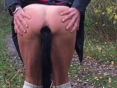 Nice ass in scotch skit with pony tail is walking