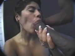Latina sucks a big black pecker