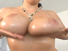Gianna Michaels plays with her massive knockers