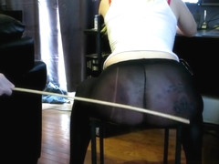 slavebc gets caned while typing out her chore list.