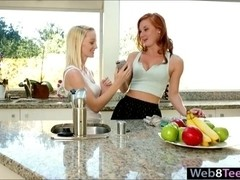 Redhead and brunette teens loves having intimate lesbian sex