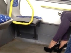 Sexy black highheels in the bus