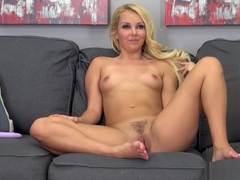 Aaliyah Love spreads her perfect body across the couch and masturbates