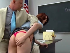 Red head receives cum on teacher desk