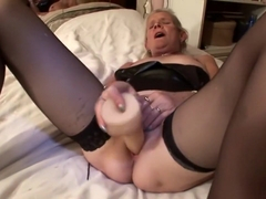 Old, blonde, Dutch, grandma masturbates and fingers her old cooch.