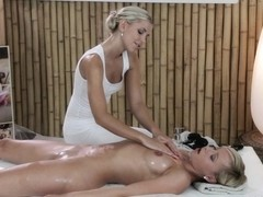 Sexy blonde lesbian is offered a professional massage