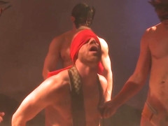 Blindfolded gay hunk subjected to orgy action