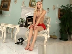 Beautiful blonde sensually plays with her toes and rubs her wet pussy