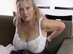 Chunky granny shows off her undressed body.