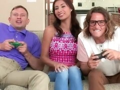 Horny slut Jade Jantzen plays video game to get the guys cocks